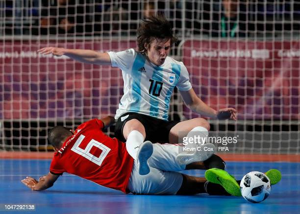 Mohamed Talaat of Egypt tackles Agustin Raggiati of Argentina in the Men's Group A match between Argentina and Egypt during the Buenos Aires Youth...