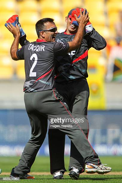 Mohamed Tauqir of the United Arab Emirates celebrates with teammate Saqlain Haider after dismissing Rilee Rossouw of South Africa during the 2015 ICC...