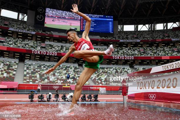 Mohamed Tindouft of Team Morocco competes during round one of the Men's 3000m Steeplechase heats on day seven of the Tokyo 2020 Olympic Games at...