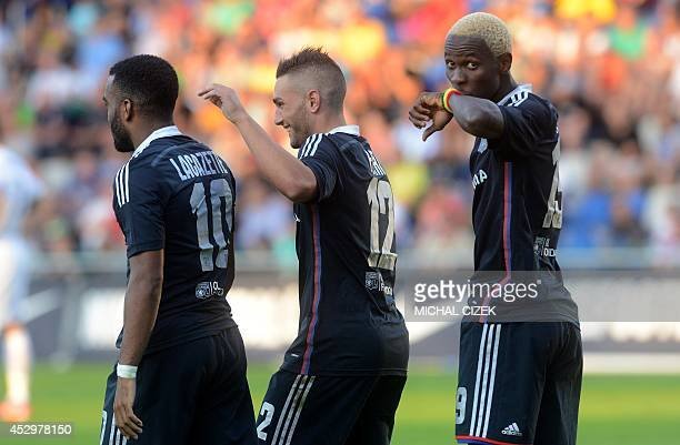 Mohamed Yattara of Olympique Lyon celebrates after scoring with his teammates Alexandre Lacazette and Jordan Ferri during the Europa League 3rd...