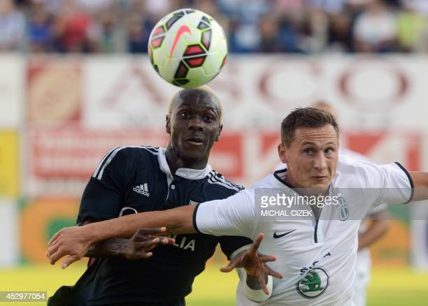 Mohamed Yattara of Olympique Lyon vies for the ball with Jan Boril of FK Mlada Boleslav during the Europa League 3rd qualifying round first leg...