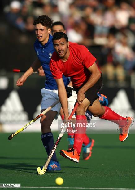 Mohamed Zaki of Egypt controls the ball from Martin Zwicker during day 8 of the FIH Hockey World League Men's Semi Finals 5th/ 6th place match...