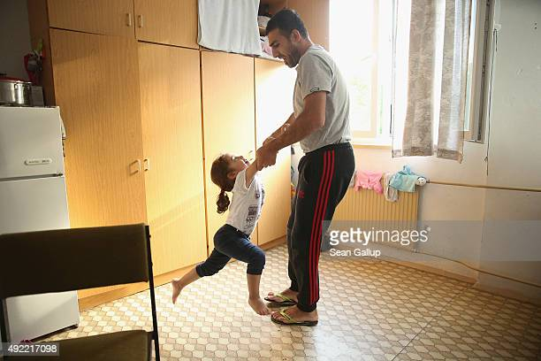 Mohamed Zayat a refugee from Syria plays with his daughter Ranim who is nearly 3 in the one room they and Mohamed's wife Laloosh call home at an...