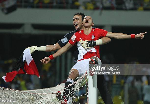 Mohamed Zidan and Kamal Tawfik celebrate their victory during the Final of the CAF African Cup of Nations played between Egypt and Cameroon in Accra,...
