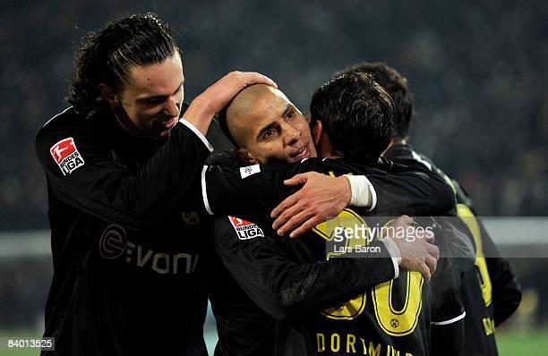 Mohamed Zidan of Dortmund celebrates scoring the first goal with team mates during the Bundesliga match between Borussia Dortmund and Borussia...