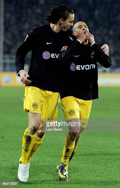 Mohamed Zidan of Dortmund celebrates scoring the first goal with team mate Neven Subotic during the Bundesliga match between Borussia Dortmund and...