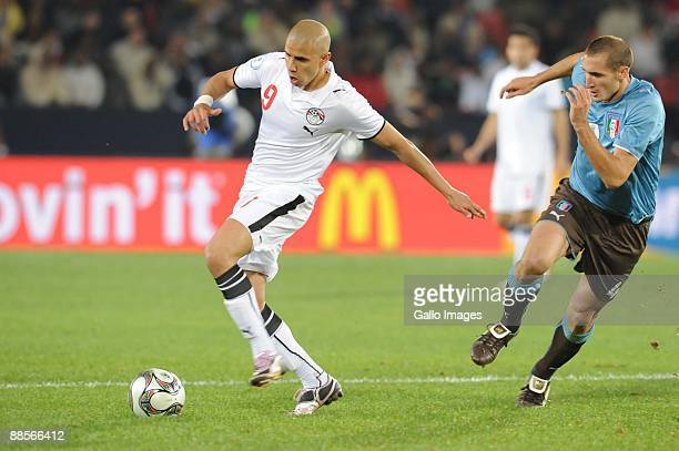 Mohamed Zidan of Egypt and Giorgio Chiellini of Italy battle during the 2009 Confederations Cup match between Egypt and Italy at CocaCola Stadium on...