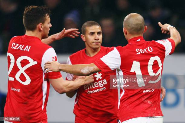 Mohamed Zidan of Mainz celebrates his team's first goal with team mates Adam Szalai and Elkin Soto during the Bundesliga match between 1899...