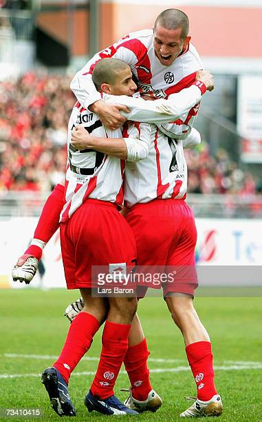 Mohamed Zidan of Mainz celebrates scoring the second goal with team mates Leon Andreasen and Petr Ruman during the Bundesliga match between FSV Mainz...