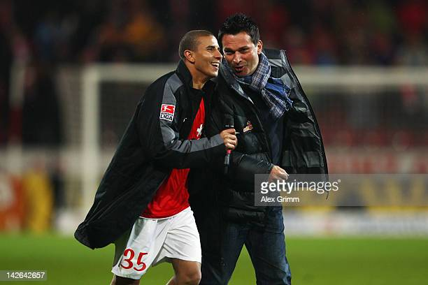 Mohamed Zidan of Mainz celebrates with manager Christian Heidel after the Bundesliga match between between FSV Mainz 05 and 1 FC Koeln at Coface...