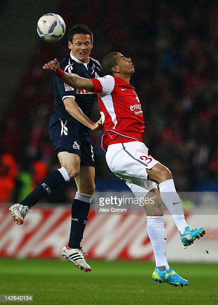 Mohamed Zidan of Mainz jumps for a header with Sascha Riether of Koeln during the Bundesliga match between between FSV Mainz 05 and 1. FC Koeln at...
