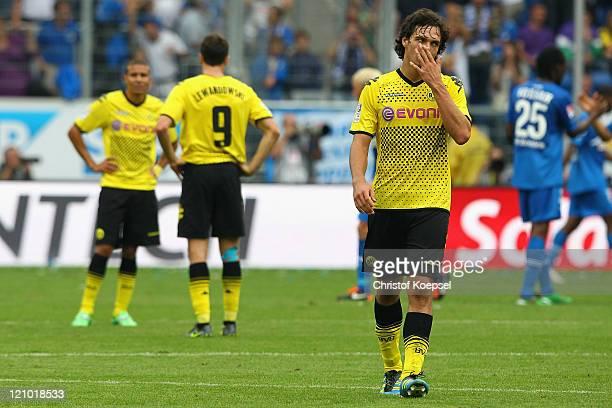 Mohamed Zidan, Robert Lewandowski and Mats Hummels of Dortmund look dejected after losing 0-1 the Bundesliga macht between TSG 1899 Hoffenheim and...