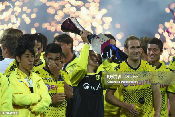 Mohamed Zidane of Dortmund celebrates with his team mates winning the LIGA total Cup finale match between BVB Borussia Dortmund and Hamburger SV at...