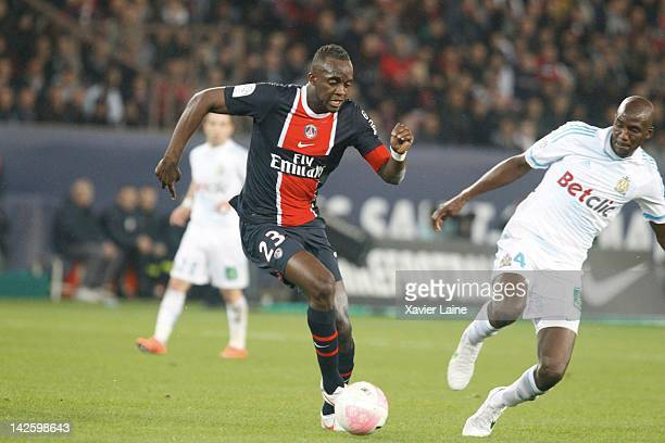 Mohames$d Sissoko of Paris SaintGermain and Stephane Mbia of Olympique de Marseille during the French Ligue 1 between Paris SaintGermain and...