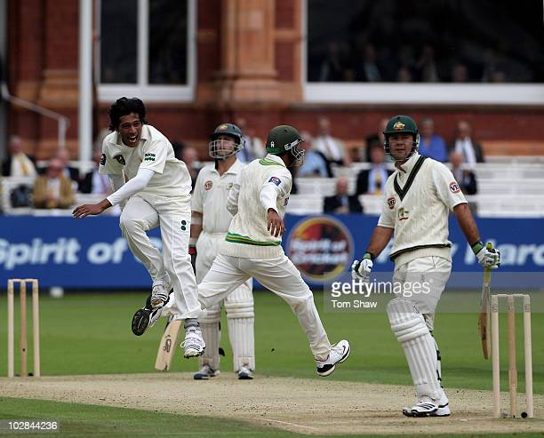 Mohammad Aamer of Pakistan celebrates taking the wicket of Ricky Ponting of Australia during the 1st Test match between Australia and Pakistan at...