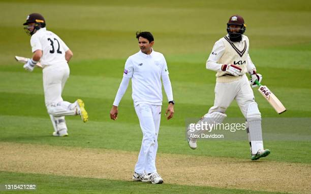 Mohammad Abbas of Hampshire reacts as Ollie Pope and Hashim Amla of Surrey pick up a run during Day Two of the LV= Insurance County Championship...