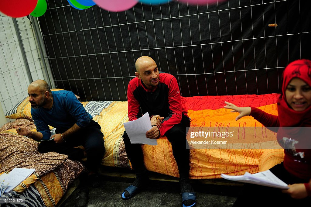 Mohammad Abdulhalim and relatives from Bagdad, Iraq, practice their German inside a shelter where they are living while their asylum applications are processed on February 25, 2016 in Sarstedt, Germany. Germany received approximately 1.1 million newcomers in 2015 and is now facing the arduous task of processing asylum claims and taking steps to integrate those whose applications are accepted.