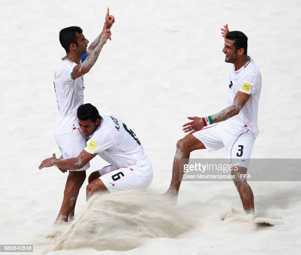 Mohammad Ahmadzadeh of Iran celebrates scoring a goal with team mates Ali Nazem and Hassan Abdollahi during the FIFA Beach Soccer World Cup Bahamas...