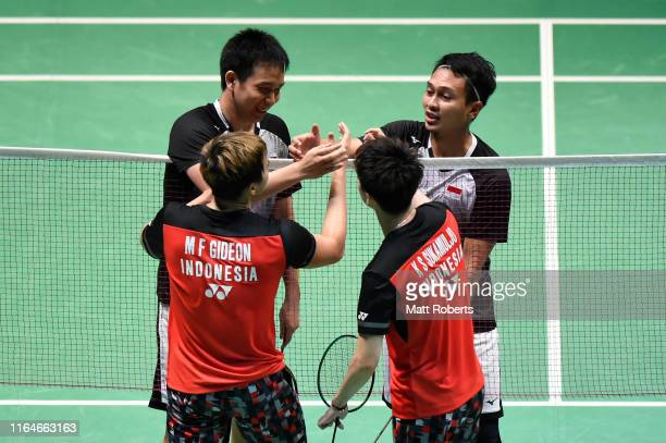 Mohammad Ahsan and Hendra Setiawan of Indonesia and Marcus Fernaldi Gideon and Kevin Sanjaya Sukamuljo of Indonesia shake hands after the Men's...