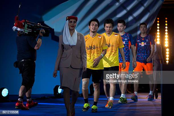 Mohammad Ahsan and Hendra Setiawan of Indonesia arrives to the award ceremony ahead of Chai Biao and Hong Wei of China after winning against them the...