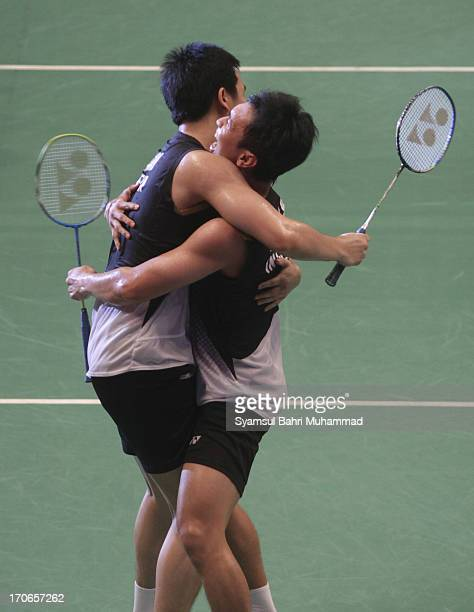 Mohammad Ahsan and Hendra Setiawan of Indonesia celebrate after winning the Badminton Indonesia Open Super Series 2013 men's doubles final match...