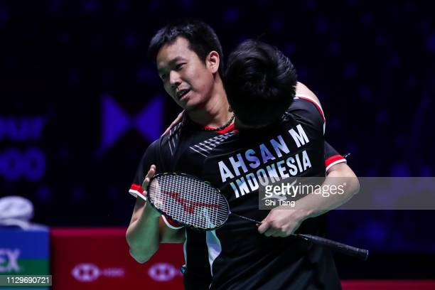 Mohammad Ahsan and Hendra Setiawan of Indonesia celebrate the victory after the Men's Double final match against Aaron Chia and Soh Wooi Yik of...