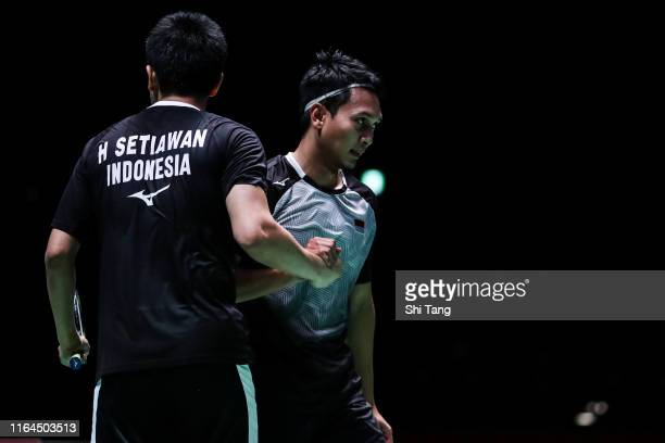 Mohammad Ahsan and Hendra Setiawan of Indonesia celebrate the victory in the Men's Doubles semi finals match against Takeshi Kamura and Keigo Sonoda...