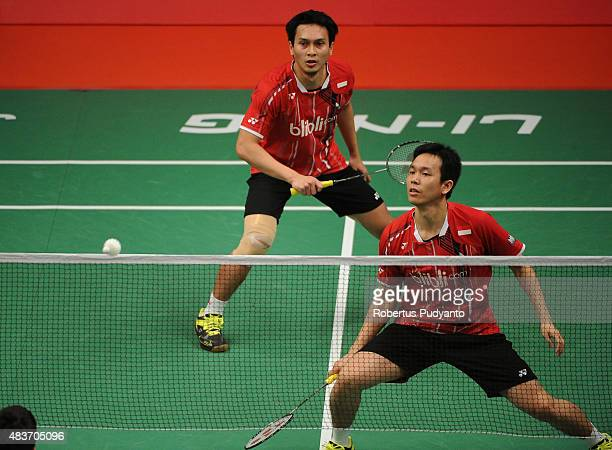 Mohammad Ahsan and Hendra Setiawan of Indonesia compete against Baptiste Careme and Ronan Labar of France in the 2015 Total BWF World Championship at...