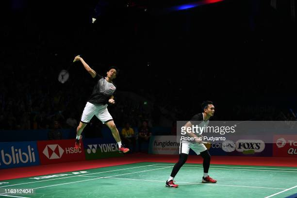 Mohammad Ahsan and Hendra Setiawan of Indonesia compete against Takuro Hoki and Yugo Kobayashi of Japan on day five of the Bli Bli Indonesia Open at...
