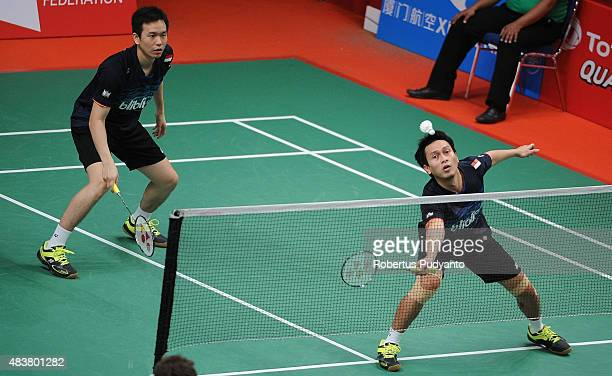 Mohammad Ahsan and Hendra Setiawan of Indonesia compete against Kenta Kazuno and Kazushi Yamada of Japan in the 2015 Total BWF World Championship at...