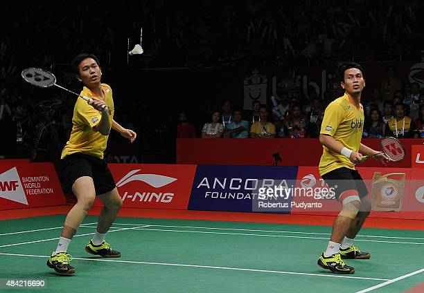 Mohammad Ahsan and Hendra Setiawan of Indonesia compete against Liu Xiaolong and Qiu Zihan of China in the men doubles final match of the 2015 Total...
