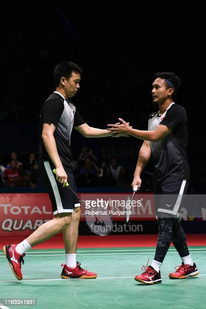 Mohammad Ahsan and Hendra Setiawan of Indonesia compete against Marcus Fernaldi Gideon and Kevin Sanjaya Sukamuljo of Indonesia during the Mens...