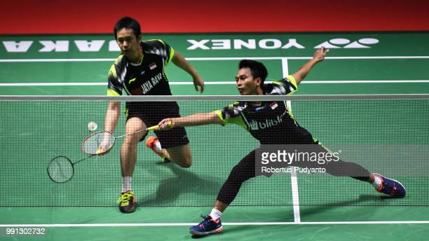 Mohammad Ahsan and Hendra Setiawan of Indonesia compete against Marcus Fernaldi Gideon and Kevin Sanjaya Sukamuljo of Indonesia during the Men's...
