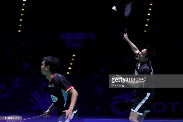 Mohammad Ahsan and Hendra Setiawan of Indonesia compete in the Men's Double final match against Aaron Chia and Soh Wooi Yik of Malaysia during day...