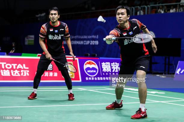 Mohammad Ahsan and Hendra Setiawan of Indonesia compete in the Men's Doubles match against Kim Astrup and Mathias Boe of Denmark during day four of...
