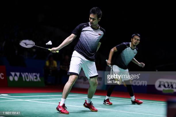 Mohammad Ahsan and Hendra Setiawan of Indonesia compete in the Men's Doubles semi finals match against Takuro Hoki and Yugo Kobayashi of Japan on day...