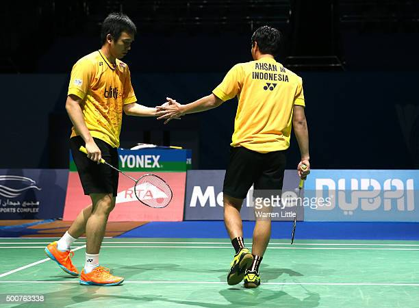 Mohammad Ahsan and Hendra Setiawan of Indonesia in action against Yong Dae Lee and Yeon Seong Yoo of Korea in the Men's Doubles match during day two...
