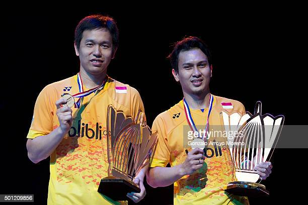 Mohammad Ahsan and Hendra Setiawan of Indonesia pose with their medals and trophy adter winning the Final Mens Double match against Chai Biao and...
