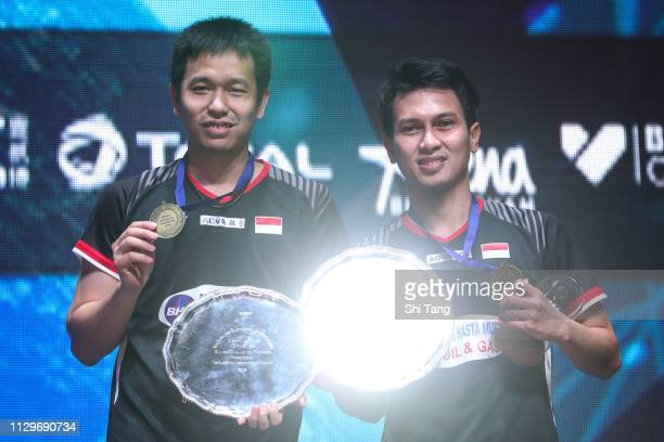 Mohammad Ahsan and Hendra Setiawan of Indonesia pose with their trophies after the Men's Double final match against Aaron Chia and Soh Wooi Yik of...