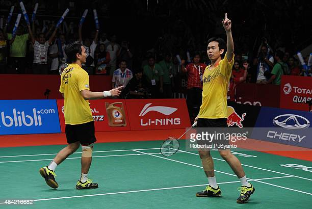 Mohammad Ahsan and Hendra Setiawan of Indonesia react after defating Liu Xiaolong and Qiu Zihan of China in the men doubles final match of the 2015...