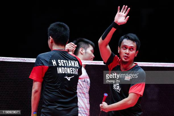 Mohammad Ahsan and Hendra Setiawan of Indonesia react after winning over the men's doubles semi final match against Lee Yang and Wang CHilin of...