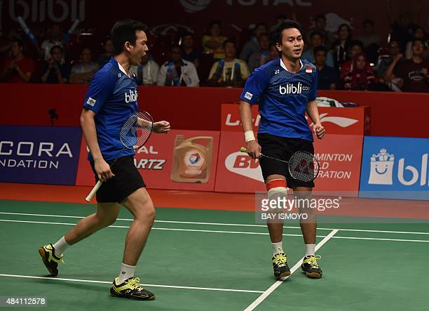 Mohammad Ahsan and Hendra Setiawan of Indonesia react against Lee Yong-Dae and Yoo Yeon-Seong of South Korea during their semi-final men's doubles...