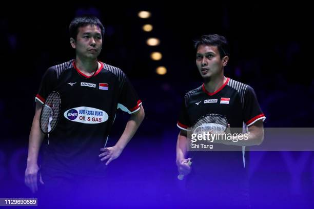 Mohammad Ahsan and Hendra Setiawan of Indonesia react in the Men's Double final match against Aaron Chia and Soh Wooi Yik of Malaysia during day five...