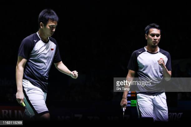 Mohammad Ahsan and Hendra Setiawan of Indonesia react in the Men's Doubles semi finals match against Takuro Hoki and Yugo Kobayashi of Japan on day...