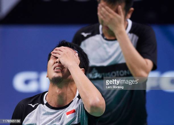 Mohammad AHSAN and Hendra SETIAWAN of Indonesia showing frustration during the 1/4 finals on day four of the DANISA Denmark Open Badminton World Tour...