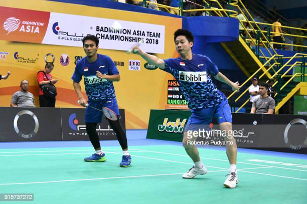 Mohammad Ahsan and Kevin Sanjaya Sukamuljo of Indonesia compete against Satwiksairaj Rankireddy and Chirag Shetty of India during the EPlus Badminton...