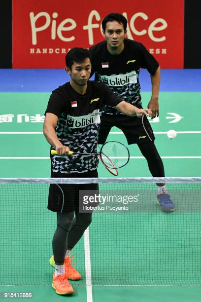 Mohammad Ahsan and Rian Agung Saputro of Indonesia compete against Carlos Antonie Cayanan and Philip Joper Escueta of Philippines during the EPlus...
