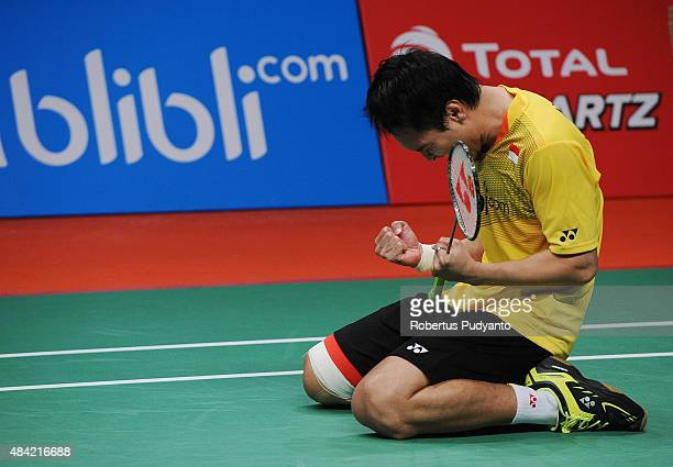 Mohammad Ahsan of Indonesia reacts after defeating Liu Xiaolong and Qiu Zihan of China in the men doubles final match of the 2015 Total BWF World...