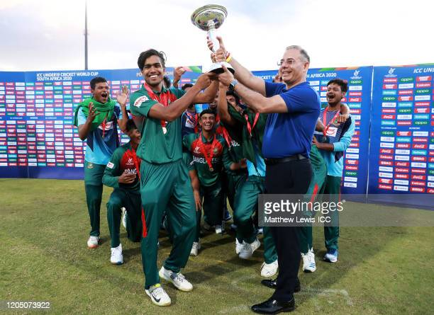 Mohammad Akbar Ali of Bangladesh is presented with the trophy from Manu Sawhney, ICC Chief Executive Officer during the ICC U19 Cricket World Cup...