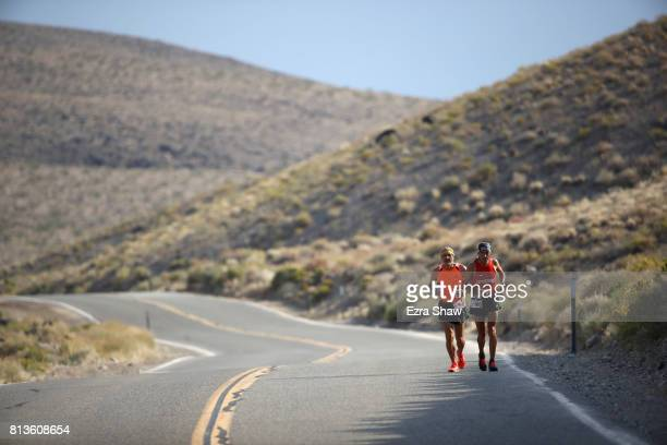 Mohammad Al Swaiti of Jordann runs with a member of his support crew during the STYR Labs Badwater 135 on July 12 2017 in Death Valley California The...